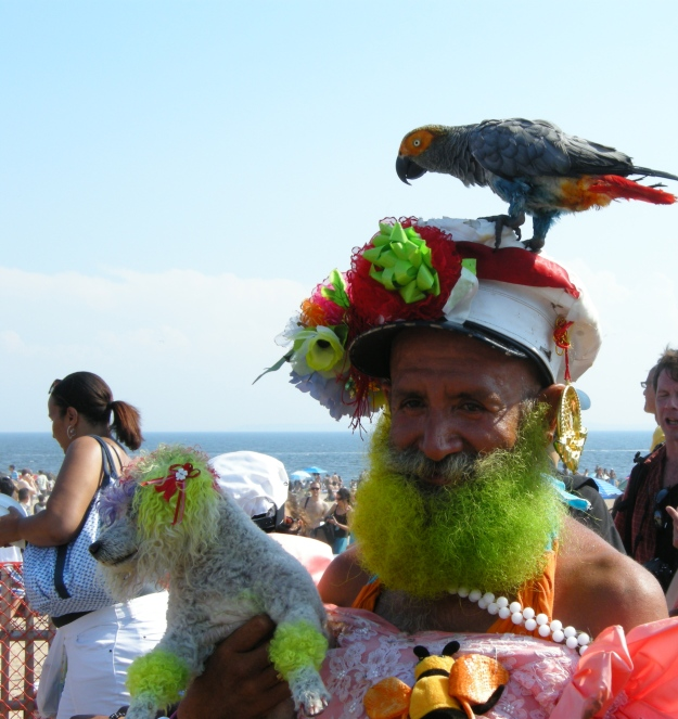 An on old merman on the boardwalk with his poodle and his parrot.  (Photo by author.)